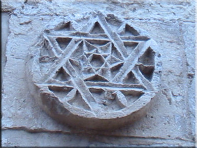 Star of David on a stone wall. CollectiveSun Blog